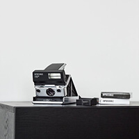 Polaroid  camera with MiNT Flash Bar